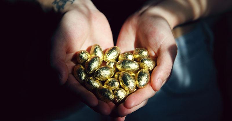 golden eggs in hand