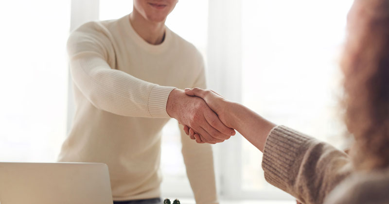 shaking hands after coming to an agreement